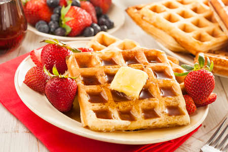 Homemade Belgian Waffles with Strawberries and Maple Syrup photo
