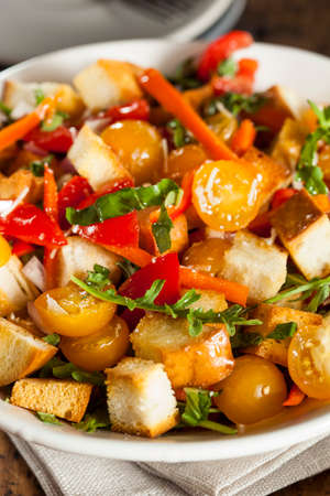 Traditional Healthy Panzanella Salad with Bread Crumbs and Veggies photo