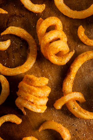 spud: Spicy Seasoned Curly Fries Ready to Eat Stock Photo