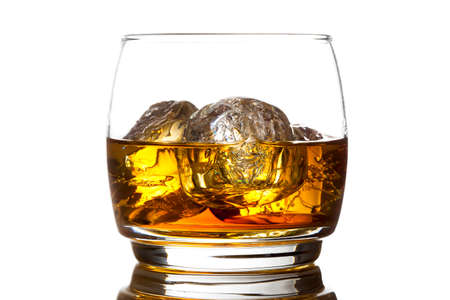 Alcoholic Amber Whiskey Bourbon in a Glass with Ice photo