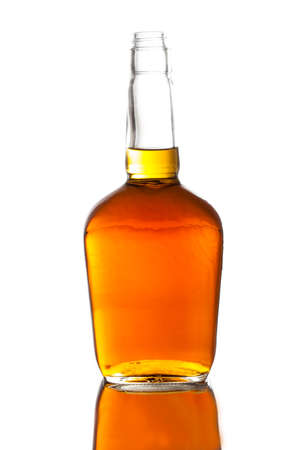 Alcoholic Amber Whiskey Bourbon in a Bottle on White photo