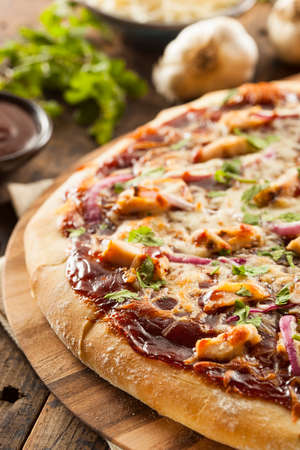 bbq chicken: Homemade Barbecue Chicken Pizza with Onions and Cilantro Stock Photo