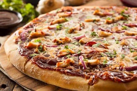 Homemade Barbecue Chicken Pizza with Onions and Cilantro Stock Photo