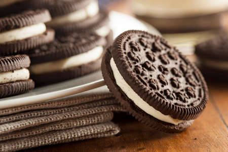 Unhealthy Chocolate Cookies with Vanilla Cream Filling photo