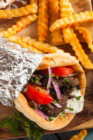 gyros: Homemade Meat Gyro with Tzatziki Sauce, tomatos and French Fries