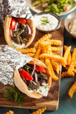 tzaziki: Homemade Meat Gyro with Tzatziki Sauce, tomatos and French Fries