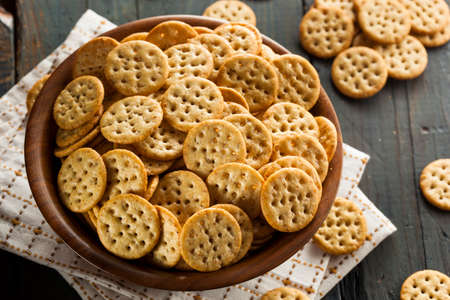 crackers: Whole Grain Wheat Round Crackers in a Bowl Stock Photo