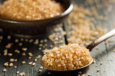 brown: Raw Organic Cane Sugar in a Bowl Stock Photo