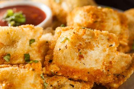 marinara: Homemade Fried Ravioli with Marinara Sauce and Basil