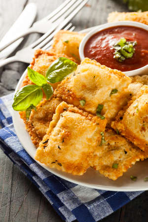 Homemade Fried Ravioli with Marinara Sauce and Basil photo