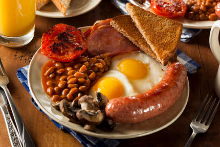 english breakfast: Traditional Full English Breakfast with Eggs, Bacon, Sausage, and Baked Beans