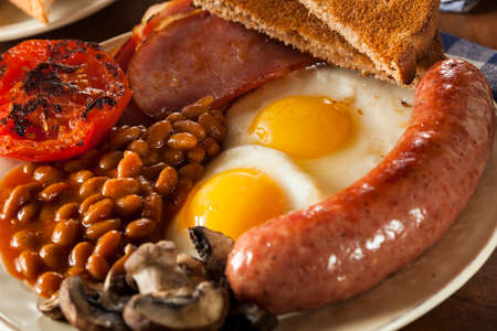 english food: Traditional Full English Breakfast with Eggs, Bacon, Sausage, and Baked Beans