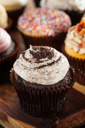 Assorted Fancy Gourmet Cupcakes with Frosting on a Background photo