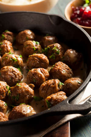 Homemade Swedish Meatballs with Cream Sauce and Parsley photo