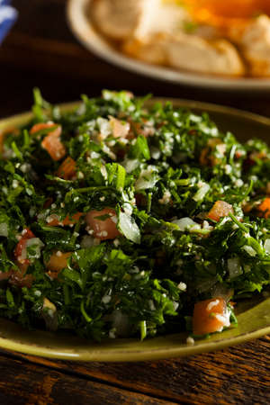 Healthy Organic Tabbouleh Salad with Tomatos and Parsley photo