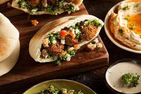 Healthy Vegetarian Falafel Pita with Rice and Salad Stock Photo