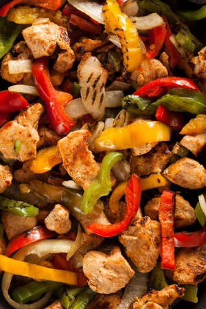 Homemade Chicken Fajitas with Vegetables and Tortillas photo