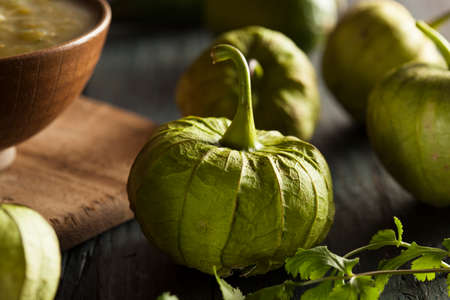 husk tomato: Group of Organic Green Tomatillos on a Background Stock Photo