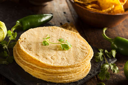 Stack of Homemade Corn Tortillas on a Background