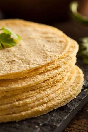 tortillas: Stack of Homemade Corn Tortillas on a Background