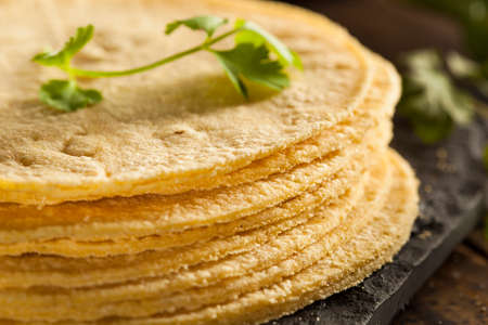 tortillas: Stack of Homemade Corn Tortillas on a Background