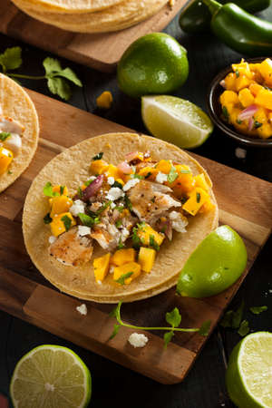Homemade Baja Fish Tacos with Mango Salsa and Chips photo