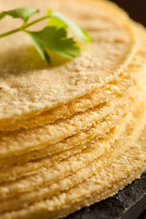 Stack of Homemade Corn Tortillas on a Background photo