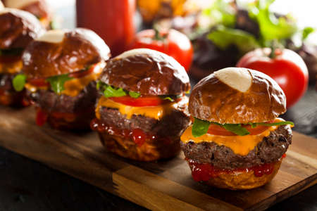 gourmet burger: Homemade Cheeseburger Sliders with Lettuce Tomato and Cheese