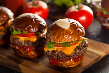 Homemade Cheeseburger Sliders with Lettuce Tomato and Cheese photo