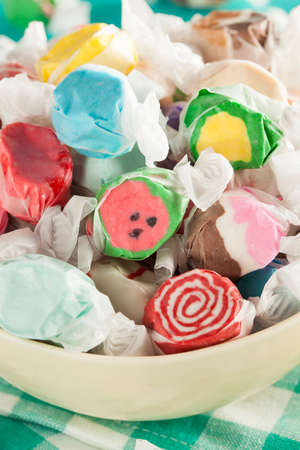 Assorted Sweet Saltwater Taffy on a Background photo