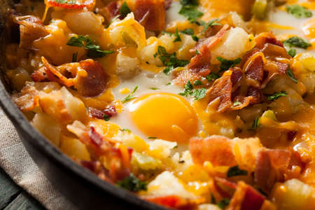Homemade Hearty Breakfast Skillet with Eggs Potatoes and Bacon Stock Photo
