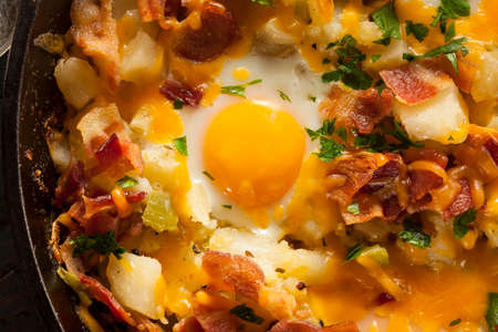 Homemade Hearty Breakfast Skillet with Eggs Potatoes and Bacon photo