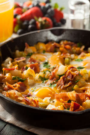 browns: Homemade Hearty Breakfast Skillet with Eggs Potatoes and Bacon Stock Photo