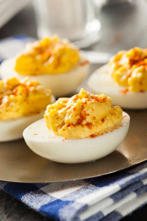 Healthy Deviled Eggs as an Appetizer with Paprika photo