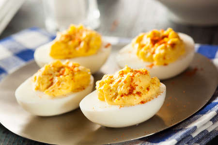 hard boiled: Healthy Deviled Eggs as an Appetizer with Paprika Stock Photo