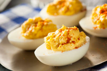boiled eggs: Healthy Deviled Eggs as an Appetizer with Paprika Stock Photo