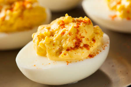 Healthy Deviled Eggs as an Appetizer with Paprika Stock Photo
