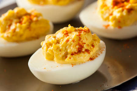 Healthy Deviled Eggs as an Appetizer with Paprika Imagens