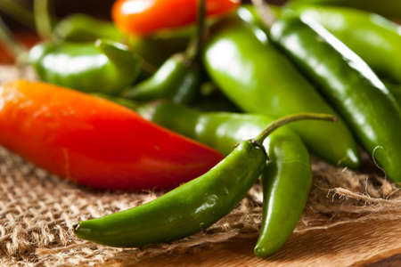 Organic Green Spicy Serrano Peppers on a Background photo