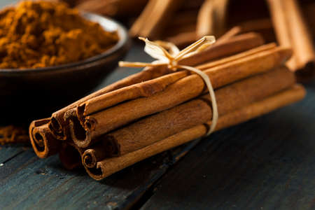 Organic Raw Brown Cinnamon on a Background photo