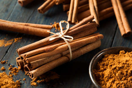 Organic Raw Brown Cinnamon on a Background