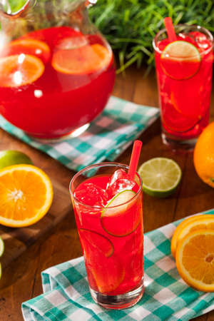 Refreshing Cold Fruit Punch with Berries and Oranges photo