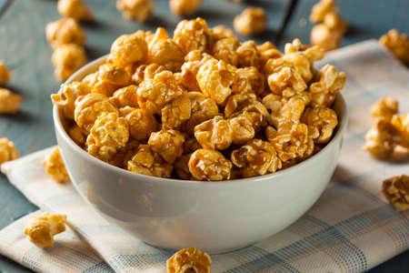bowl of popcorn: Homemade Golden Caramel Popcorn in a Bowl