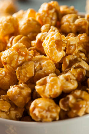 Homemade Golden Caramel Popcorn in a Bowl photo