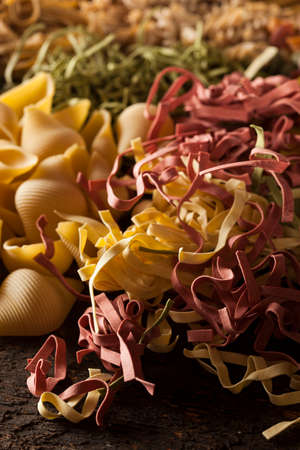 Assorted Homemade Dry Italian Pasta on a Background photo