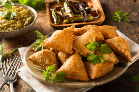 pakistani food: Homemade Fried Indian Samosas with Mint Chutney Sauce