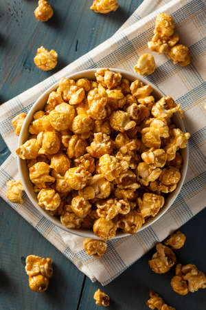 Homemade Golden Caramel Popcorn in a Bowl