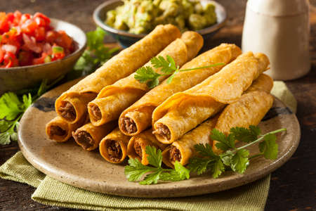 corn tortilla: Homemade Mexican Beef Taquitos with Cilantro and Salsa