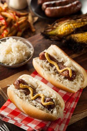 bratwurst: Homemade Bratwurst with Sauerkraut and Mustard Stock Photo