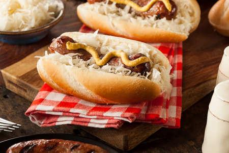 Homemade Bratwurst with Sauerkraut and Mustard Stock Photo